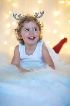 Portrait photoshoot / photography  / red / blue eyes / christmas / christmas lights / lights / Rudolph / reindeer