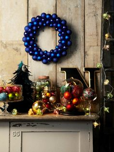 An artsy holiday is all about creating interesting vignettes mixing holiday decor with what you already have