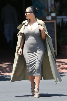 Fashion website for Kims outfits (most already saved to fashion websites) This Is the Reason Kim Kardashian's Outfits Look So Expensive: Kim stuck to her signature silhouette — a body-hugging tank dress and duster coat, this time in shades of tan and gray.