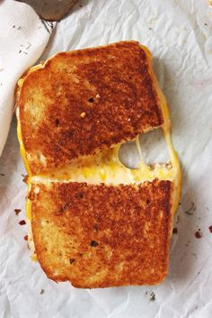 Fancy Schmancy Grilled Cheese - Brushed with a garlic, red pepper flake, and thyme infused butter and stuffed with three different cheeses - Asiago, Meunster and Cheddar.