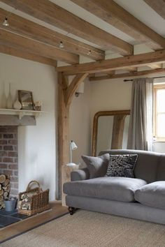 soft grey against white walls and new oak beams (fabulous grey linen curtains) -. - soft grey against white walls and new oak beams (fabulous grey linen curtains) - The Paper Mulberry: White Cottage Living Rooms, Cottage Interiors, Home Living Room, Living Room Decor, Style At Home, Salons Cottage, Border Oak, Oak Frame House, Rustic Sofa