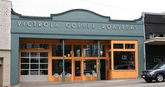 BEAUTIFUL front facade..love the color to play off the natural surfaces  Victrola Coffee Roasters in Seattle