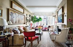 In Alexa Hampton's New York living room, a detail of the Parthenon's frieze, painted by Hampton, hangs above the custom-made sofa, which is covered in a Kravet fabric; the klismos chair is by Alexa Hampton for Hickory Chair, Louis XVI chairs flank the mantel (designed by Hampton for Chesney's), and the Irish matting is by Crosby Street Studios.