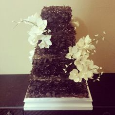 Chocolate curl square wedding cake with white orchids