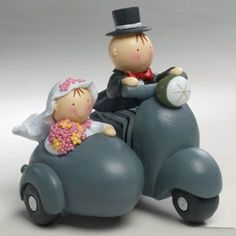 Unusal wedding cake topper design.  I love it.