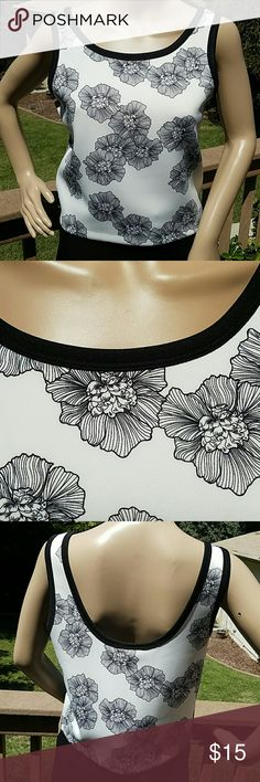 Pretty Metaphor White & Black Top - Size M    NWT Brand new top with beautiful flower design. Top looks great by itself or with a black jacket. Size M. Never worn. Excellent condition. Comes from smoke-free home. Metaphor Tops