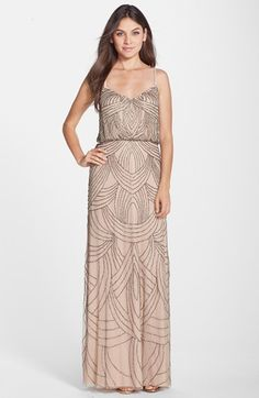 Free shipping and returns on Adrianna Papell Beaded Chiffon Blouson Gown at Nordstrom.com. Delicate straps crisscross the back of an elegant gown that catches the light with a swirling Art Deco pattern of delicate, shimmering beads. The blouson silhouette works well with all figure types.