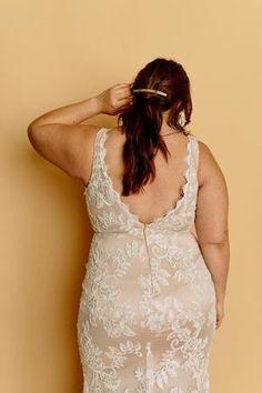 Tara – Halseene A fitted curve wedding gown with a centre slit, deep v back, plunging neckline and creamy lace over a mocha lining. #HalseeneTara #plussizeweddingdresses #plussize…