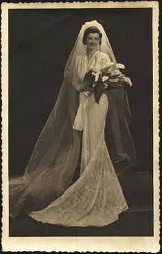 Bride in lace dress, c. 1930s.