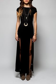love the slits in the long black dress - great for wearing tall boots. (also like the half-moon necklace.)