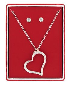 Love this Crystal & Silvertone 1'' Asymmetrical Open Heart Pendant Necklace Set on #zulily! #zulilyfinds #jewelry #jewelrysale #giftidea #sale #gift #fashion #fashionjewelry #pavcusdesigns #pavcus #womensfashion #womensjewelry #bling #springfashion #necklace #earrings #heartjewelry