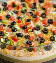 This Is Our Family's Favorite 7 Layer Bean Dip Recipe! It Has Loads Of Flavor And All Your Favorite Dip Ingredients Including Avocados, Olives, Tomatoes, Cheese, Guacamole And More! It's A Must-Have Appetizer At Every Family Function. Mexican Appetizers, Best Appetizers, Mexican Food Recipes, Appetizer Recipes, Holiday Appetizers, Healthy Recipes, Mexican Dishes, Vegetarian Recipes, Dinner Recipes