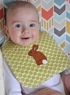 """A sugar catcher for a special little baby!  That's Sashiko flip-stitched cording decorating the edge of this appliqued, quilted baby bib. The applique design is from """"Baby Rabbits"""" by A Bit of Stitch. There's a hand embroidery version of these designs too!"""