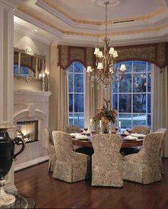 What a gorgeous set of treatments for a bay window, really sets of the space!