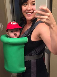 Super Mario baby carrier costume! Floral wreaths, cut in half, with foam sheets hot glued on. Elastic from top of the pipe around my neck. All supplies from Hobby Lobby including the mustache tattoos! #hobbysupplies Halloween Infantil, Cute Baby Halloween Costumes, Funny Baby Costumes, Baby Halloween Costumes For Boys, Stroller Halloween Costumes, Family Costumes, Scary Baby Costume, Babies In Costumes, Mom And Baby Costumes