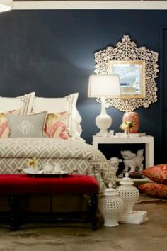 the mirror  ikat pillows on bed ( I would trip over those vase things but other than that, great bedroom decor)