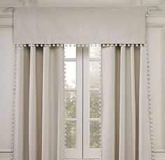 Love these neutral curtains with the pom pom trim.  Polished and unfussy at the same time.