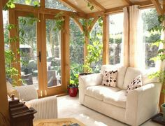 Interior, Fantastic White Soft Sofa And Red Pots Also Elegant Glass Wall With Wooden Frames: Awesome Small Sunroom Ideas