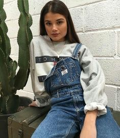 Streetstyle crewneck sweater streetstyle overalls streetwear tommy hilfiger sweater hoodie brunette center part brick wall womens fashion Fashion Killa, Look Fashion, 90s Fashion, Winter Fashion, Fashion Outfits, Womens Fashion, Robes Glamour, Fall Outfits, Casual Outfits