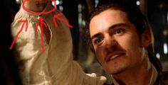 Orlando's elvish tattoo shows up in Pirates of the Caribbean. I wondered how many people actually noticed this. The tatoo is also the reason why later on in film Orlando has his cravat tied around his wrist. And by the way, at the very end of the film(2:12:44) you can catch a glimpse of a random guy in a cowboy hat and sun glasses. For some reason I don't think he was one of Jack's crew.