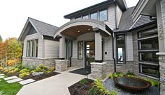 Stacked stone framing garage and on base of column (but less stocky), in darker color scheme to coordinate with home and pathway... Eldorado Stone - Imagine - Inspiration Gallery - Residential - Facades