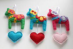 Eco Felt Dala Horses Red, Teal, & Hot Pink  by lova revolutionary, via Flickr