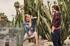 Yooniq images - Two women taking pictures in cactus park