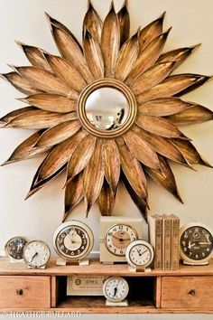 Flower mirror and vintage clocks Palm Frond Art, Palm Fronds, Flower Mirror, Sunburst Mirror, Mirror Mirror, Copper Mirror, Mirror Bedroom, Mirror Ideas, Wooden Flowers