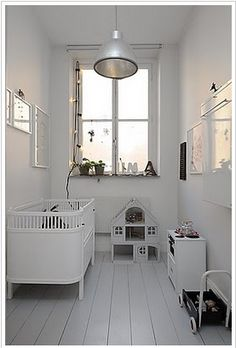 All white nursery - I seem to be drawn to Nursery's that are way more stark, colourless and adult than my own space is. Go figure.
