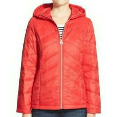 """Guess puffer jacket NWT Guess from Wilson's Leather. Beautiful red hooded puffer jacket. Princess seams and mitered quilting streamline a sporty puffer coat that offers travel-friendly, packable?style so you can bring that extra pair of boots along, too.  26"""" length. Front zip closure. Attached hood. Long sleeves. Front hidden-zip pockets. Fully lined, with 100% polyester fill. 100% polyester. Machine wash cold, tumble dry. Made by Guess. Guess Jackets & Coats Puffers"""