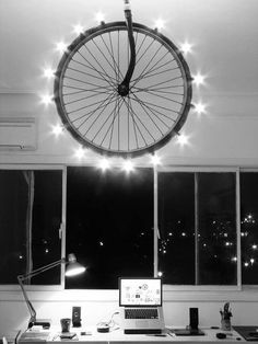 Lighting wheel  Looks like a cool DIY project with a bike tire, a ceiling rack and Christmas lights