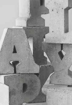 Hand-made letters, cast in concrete using unique wooden formworks. Sigurd Larsen with Playtype Copenhagen.