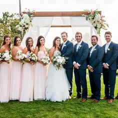 You can never go wrong with a blush pink and navy blue wedding party.