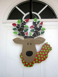 Reindeer Door Hanger, Reindeer Wreath, Christmas Reindeer Door Decor, Rudolph Door Hanger. $44.95, via Etsy.