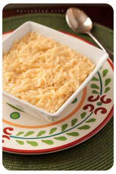 Easy-Cheesy Orzo:  16(oz) chicken or vegetable broth  1 cup orzo pasta  1/2 cup grated cheddar cheese  1/4 cup grated Parmesan cheese  salt & pepper, to taste