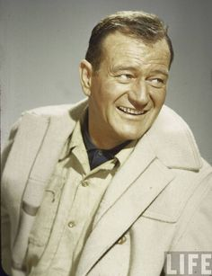 John Wayne -     Wayne's rugged masculinity landed him a number of lead film roles in westerns. 142 of his roles were as the lead actor. Date: 1957. Photographer: Loomis Dean.