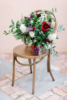 Copper Metal Bistro Dining Chair for Wedding Ceremony and Reception Seating with Organic Red and Purple Bridal Bouquet as Featured on Ruffled Blog via Birch & Brass Vintage Rentals for Weddings and Special Events in Austin, Texas. Photography by @juliewilhite.