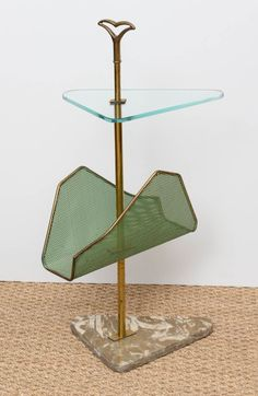 Anonymous; Brass, Glass, Marble and Enameled Metal Side Table, c1950.