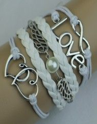 Infinity, love, pearl, heart wrap bracelete.  Vamp up your accessories collection this spring with an eye catching bracelet from Modestly!