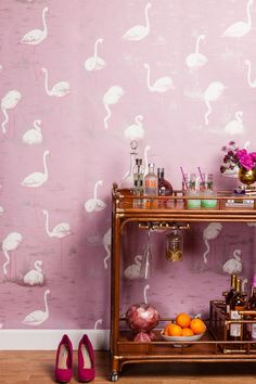 Lovely styling on the bar cart. Cute shoes. But really, pink flamingo wallpaper?!?! Can it get any more fabulous than that?!