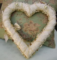 Romancing the Bling - heart - shaped wreath form covered in satin ribbon and lace and vintage jewelry and buttons.  Lots of inspiration - via Romancing the Bling