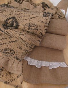 table runners ~~ burlap.  The fabric on your left can be purchased at JoAnn's fabric.