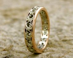 Scrolls and white gold make for a lovely, vintage style wedding ring.  Not your regular wedding ring with engravings on the surface. Our rings with scrolls have a highly detailed pattern all around, eternity-style.  Width is 3 mm but can be customized. Gems can be set in the scrolls.  Our scroll rings are elegant with a vintage feel. They would be lasting wedding or anniversary gifts, for her as well as for him.  US size 6, glossy, micro-stamped 14K.  We are looking forward to make this ring…