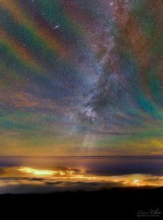Rainbow Airglow over the Azores - Why would the sky glow like a giant repeating rainbow? Airglow. Now air glows all of the time but it is usually hard to see. A disturbance however  like an approaching storm  may cause noticeable rippling in the Earths atmosphere. These gravity waves are oscillations in air analogous to those created when a rock is thrown in calm water. The long-duration exposure nearly along the vertical walls of airglow likely made the undulating structure particularly…