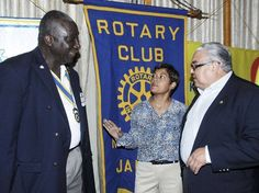 Article about funds pledged to Crayons Count.  Photo: Deika Morrison discusses the concept of Crayons Count to Effiom Whyte (left), president of the Rotary Club of Kingston, and Robert MacMillan, honorary consul, Consulate of Iceland, during the club's weekly luncheon at The Jamaica Pegasus hotel in New Kingston yesterday. - Ian allen/Photographer.