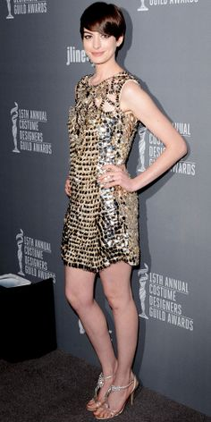 Anne Hathaway caught our eye at the Costume Designers Guild Awards in an embellished Gucci minidress, brown diamond Julieri studs, Kwiat bangles and jeweled sandals. Anne Jacqueline Hathaway, Gold Sequin Dress, Metallic Dress, Gucci Dress, My Hairstyle, Hairstyles, Glamour, Designers Guild, Red Carpet Looks