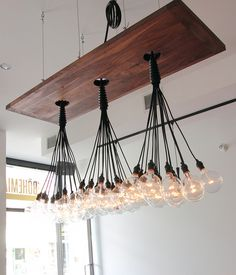 Raw Lightbulb Fixture  An eye catching installation in the dining room.