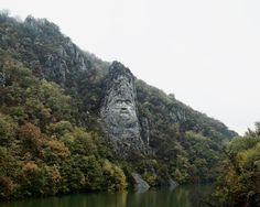 Tamas Dezso, Decebal statue (Near Orsova, South Romania), from the series Notes for an Epilogue, The Photographers' Gallery Nature Story, Rock Sculpture, Sculptures, Great Backgrounds, Art Corner, Documentary Photography, Eastern Europe, Travel Inspiration, Cool Photos