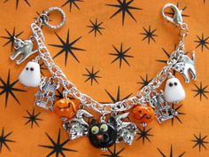 Beautiful One of a Kind Halloween Charm Bracelet with Black Cat, Ghosts, and Pumpkin Lampwork Glass Beads, and Pewter Witch, Haunted Houses, and Halloween Cat Charms by MelancholyMind on Etsy