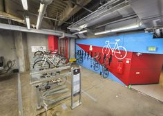 Bike Parking Room With Two-tier bicycle parking and vertical bike rack wall mounted Offset Donation Boxes, Bike Parking Rack, Vertical Bike Rack, Skateboard Rack, Cycle Store, Bin Store, Parking Solutions, Outdoor Shelters, Bike Room